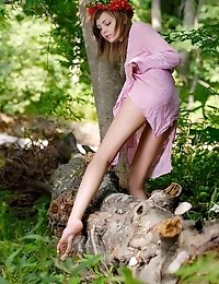 Fabulous Nude Kitten Is Sitting In The Forest In Bright Read Garland And Poses Energetically In Fron