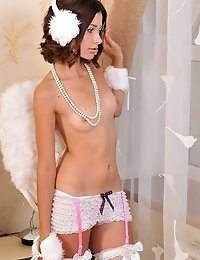 Delicious Teen Angel In Enticing White Lingerie Showing Off Her Ass And Pussy On The Bed.
