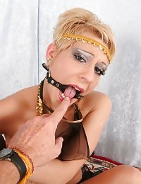 Short haired arabic slave Amber Wild gets chained up and gagged by her master