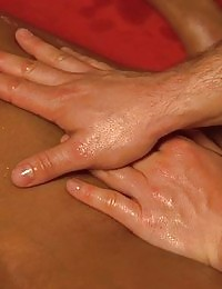 He gives his girl friend an oily massage