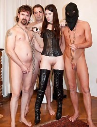 Naughty mistress gets fucked by two slaves