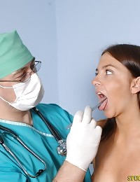 Perky doctor undresses a babe for a dirty exam