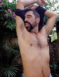 Hairy gay bear show off his hairy chest muscles and drop his pants to stroke his cock