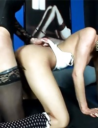 Shemale sluts bang their asses on a shared dildo