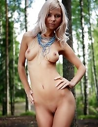 Very Hot Leggy Blonde Teen Girlie Is Going To Pose For You Absolutely Nude Right In A Forest.