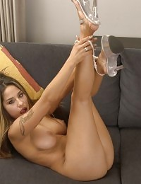 Gorgeous sexy and hot porn babe dildo fucking naked on the couch