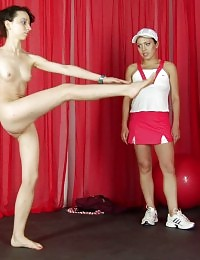 Tall sports girl obeys a petite cruel trainer