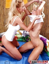 Two incredible blond lesbians kissing teasingly and oiling their round asses
