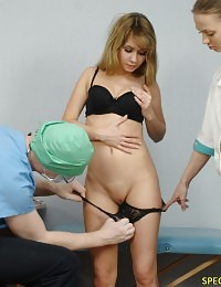 Male doctor examines a nude babe with nurse help