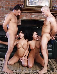 Eva Angelina and her friend make out in front of two guys to stir up the mood in a cluster fuck