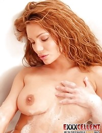Red haired cute chick vibrating her wet snatch in the bath tub