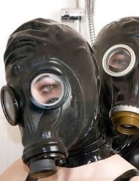 Two sluts in gas masks play in the shower