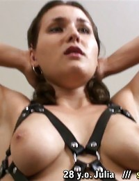 Big-titted fitness girl exercised nude in a harness
