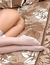 Delicious Busty Long Haired Sweetie In Enticing White Stockings Spreading Legs On The Bed.