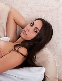 She Will Make You Feel Warm And Welcome As She Poses Naked And Gazes At You With Her Beautiful Brown